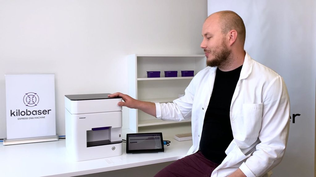 Alexander Murer, CEO of Kilobaser GmbH shows how to make DNA yourself with Kilobaser. Kilobaser DNA Synthesizer machine for in-house DNA Synthesis. Microfluidic chip based. Synthesize DNA oligos, DNA primer, DNA probes in less than 2h.